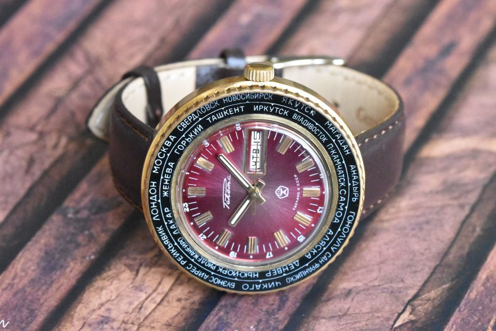 Raketa World Time / Goroda with a striking bordeaux dial